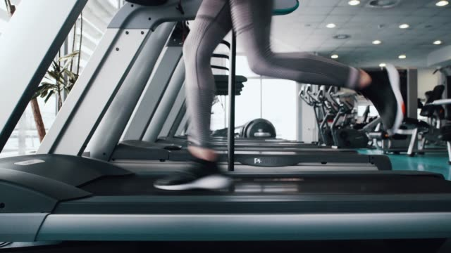 sport women running on treadmill cardio equipment - thin stock videos & royalty-free footage