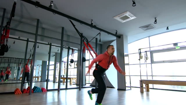 sportive man doing rope exercise with his full body - fitness ball stock videos & royalty-free footage