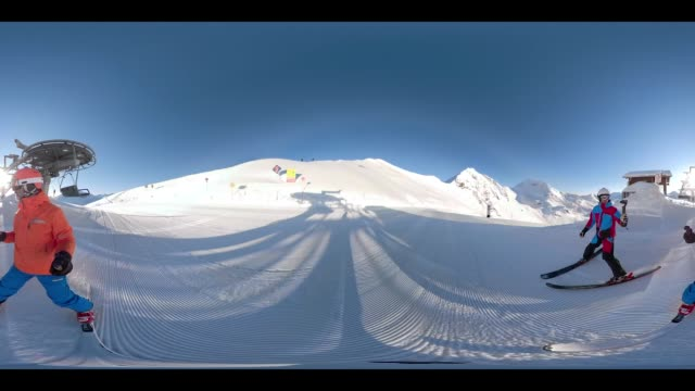 360 VR Sports - 360VR two skiers on sunny winter day in 4K