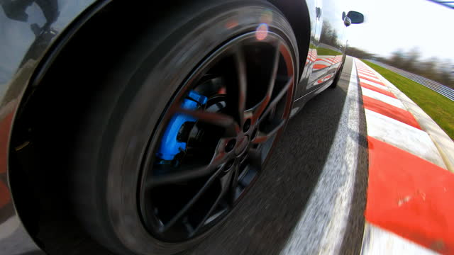 sports car driving fast around the bend on a race track - accelerator pedal stock videos & royalty-free footage