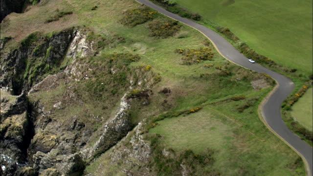 sports car racing through dramatic mountain roads - isle of man stock videos & royalty-free footage