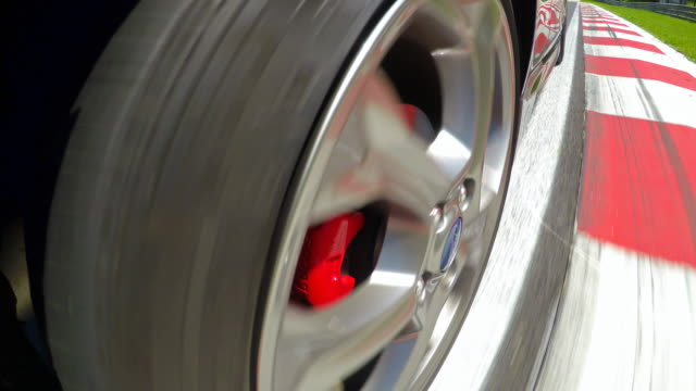 Sports car wheels spinning during a motor sport event competition