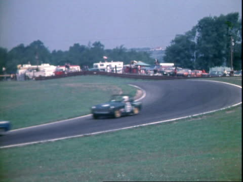 sports cars driving on pace lap of under 2500 cc transam auto race at midohio sports car course / sports cars including bmc mini cooper s triumph tr4... - bikini top stock videos & royalty-free footage