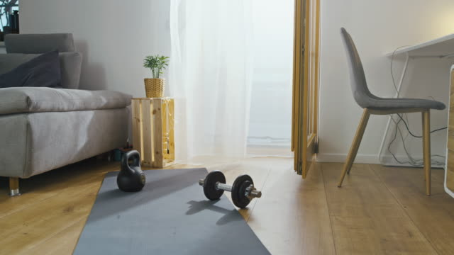 slo mo sports equipment laying on the exercise mat in the living room - exercise room stock videos & royalty-free footage