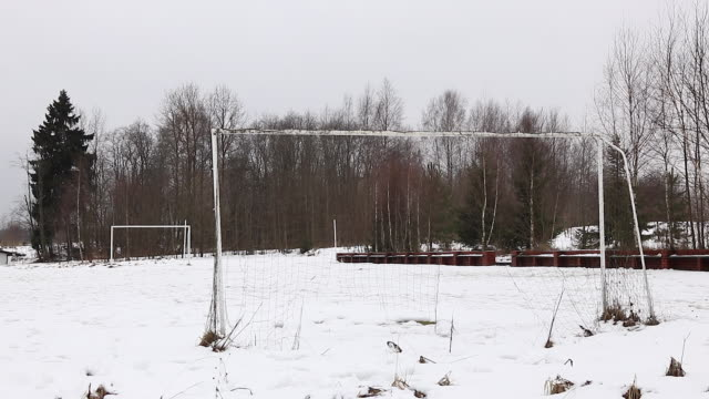 sports equipment under the snow, football field - sports field stock videos and b-roll footage