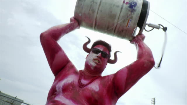 slo mo ms la sports fan wearing body paint holding keg of beer in air, jacksonville, florida, usa - keg stock videos and b-roll footage