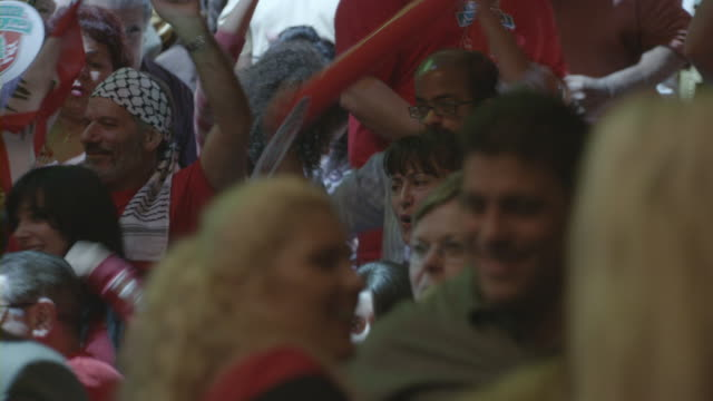 sports fans cheering and dancing in a stadium. - spruchband stock-videos und b-roll-filmmaterial