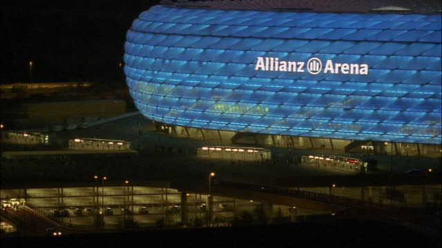 Sports fans exit the Allianz Arena.