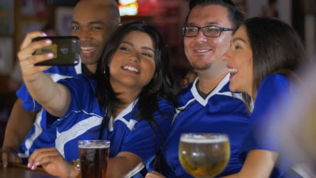 sports fans taking a selfie at bar - bar stock videos & royalty-free footage