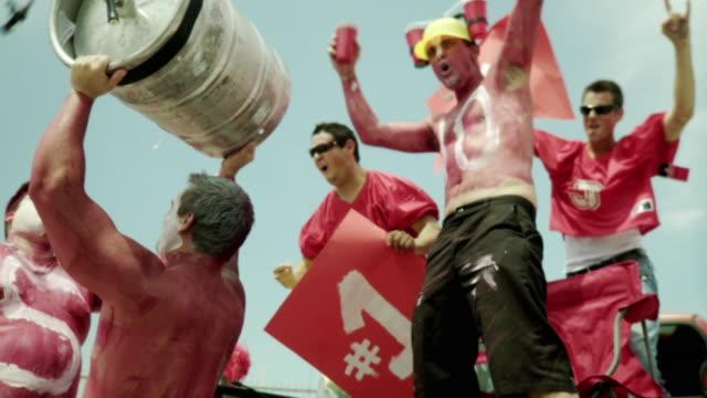 SLO MO MS Sports fans wearing body paint celebrating, Jacksonville, Florida, USA