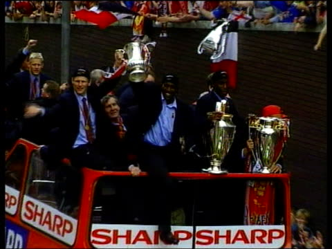 stockvideo's en b-roll-footage met football manchester united lib england manchester ext seq manchester united players atop opentop bus with three trophies as parade thru streets in... - 1990 1999