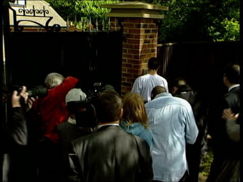 football wold cup roy keane arrives home itn england cheshire bv keane away to gate of house and presses intercom bv keane away towards house with dog - intercom stock videos and b-roll footage