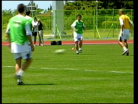 sports football world cup england injury worries ext england players at training session lms injured england player nicky butt kicking ball around at... - sinclair institute stock videos and b-roll footage