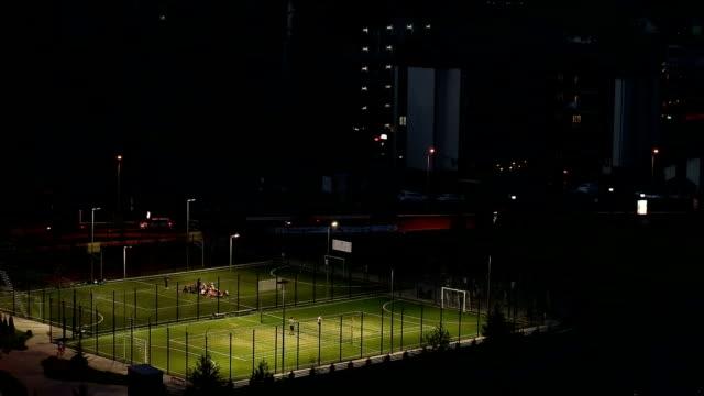 sportplätze in den resort-stadt bukovel. - football feld stock-videos und b-roll-filmmaterial