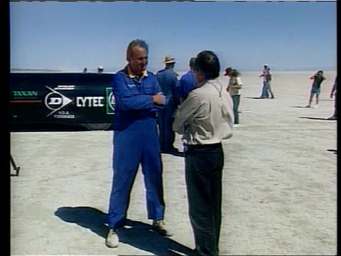 land speed record attempt; cf tape no longer available itn usa: nevada desert: gv thrust ssc being prepared for test run mss mechanics dusting down... - nevada stock videos & royalty-free footage