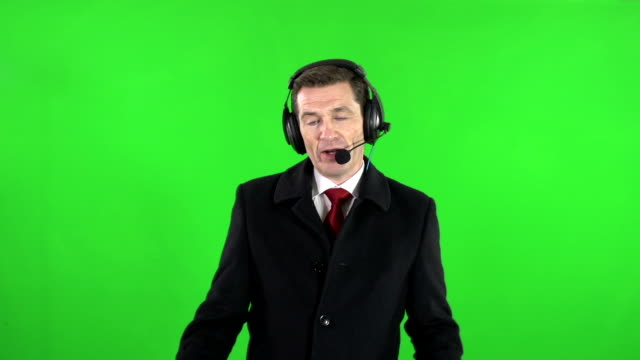 TV / Sports reporter or Commentator with headset microphone on Green Screen