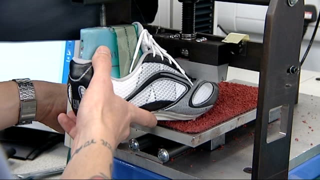sports scientists help competitors improve performance loughborough university machine working on athletic shoe trainers being fitted on man's feet - レスターシャー点の映像素材/bロール