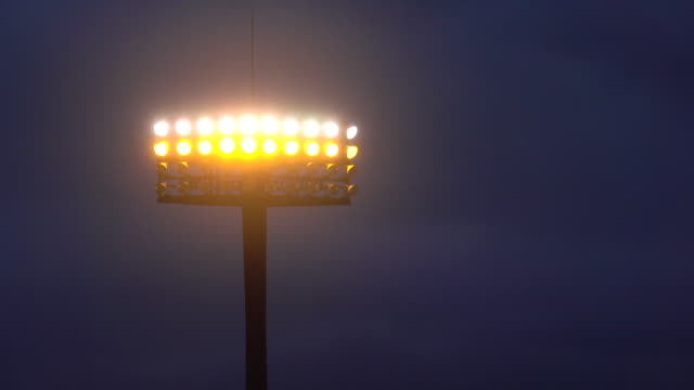 sports stadium lights at dusk - football pitch stock videos & royalty-free footage