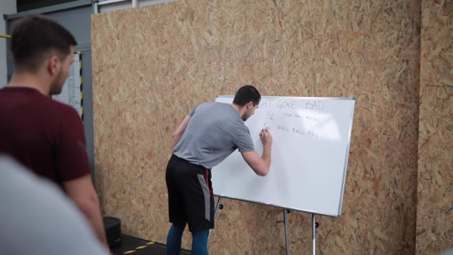 sports trainer writing training plan on white board - whiteboard stock videos & royalty-free footage