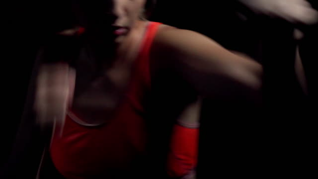 Sports training women boxer. Quick and precise blows