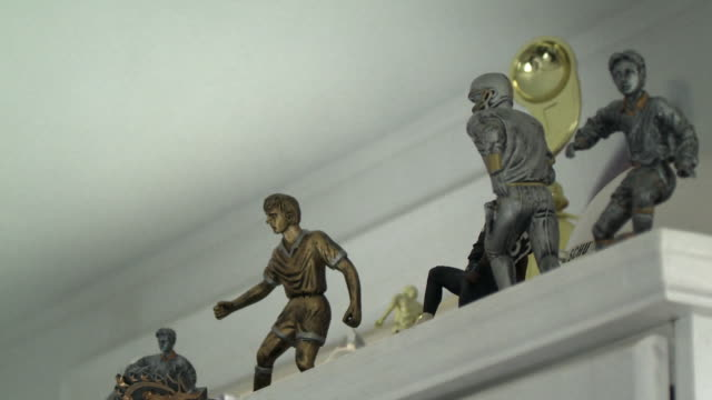 cu la pan sports trophies on shelf in boy's room, scarborough, new york, usa - cup stock videos & royalty-free footage