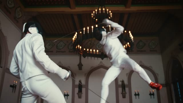 sportsman striking rival with epee sword - flexibility stock videos & royalty-free footage