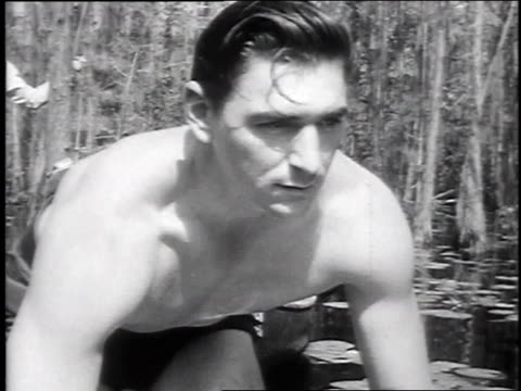 1947 montage sportsman wrestling alligator / okefenokee swamp, georgia, united states - play fight stock videos and b-roll footage