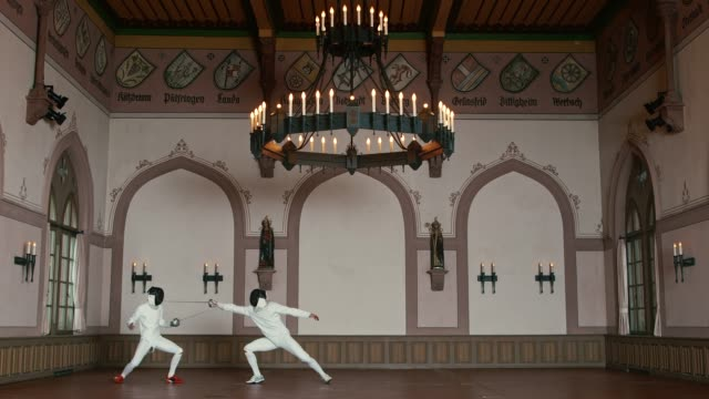 sportsmen fighting with epee swords in castle - rivalry stock videos & royalty-free footage