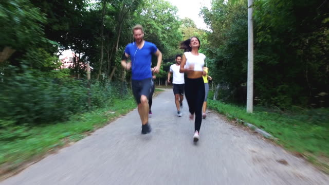 sportspeople running on road in nature - running shorts stock videos & royalty-free footage