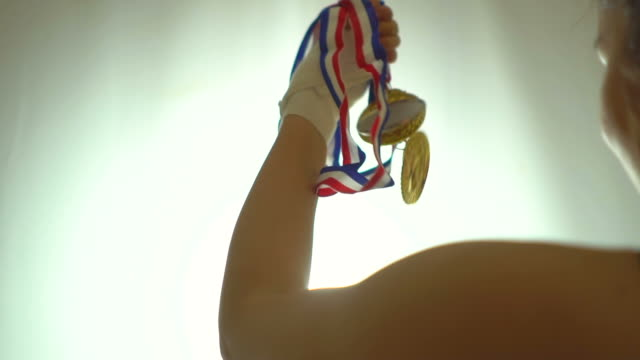 sportswoman celebrating her win with gold medals - athleticism stock videos & royalty-free footage