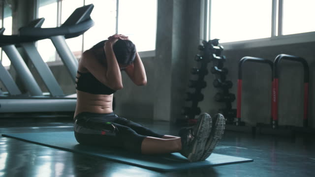 sportswoman doing situps in gym - cross training stock videos & royalty-free footage