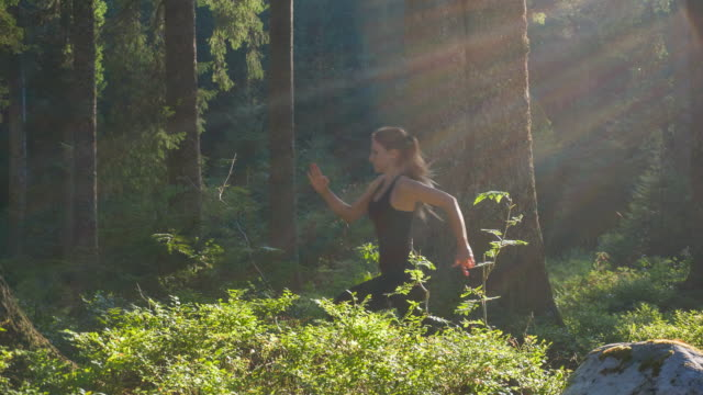Sportswoman running in nature