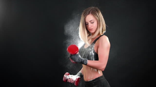 Sporty fitness woman exercising with dumbbells