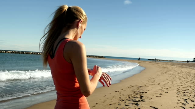 Sporty girl using smart watch