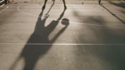 Sporty man dribbling ball on basketball court