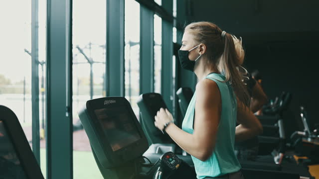 sporty people exercising in fitness gym - treadmill stock videos & royalty-free footage