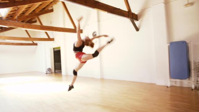 Sporty woman in a gym dance floor