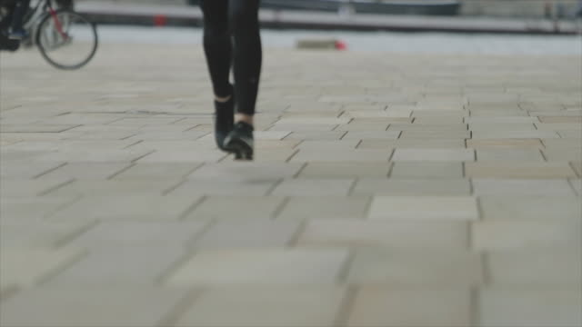 sporty woman jogging in the city: running shoes - oresund region stock videos & royalty-free footage