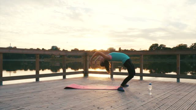 sporty woman practicing backbend. - head back stock videos & royalty-free footage