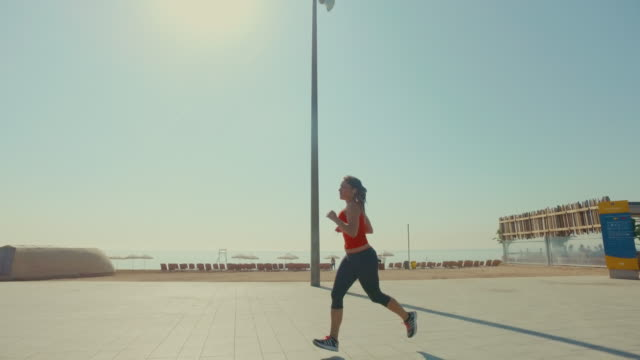 Sporty woman running and training alone