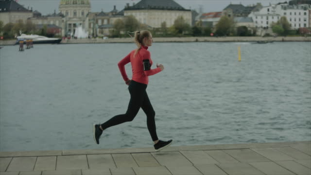 sporty woman running in the city - tall high stock videos & royalty-free footage