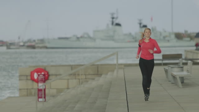 sporty woman running in the city - man and machine stock videos & royalty-free footage