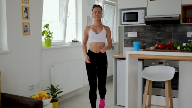 sporty woman runs in place at home - physical pressure stock videos & royalty-free footage