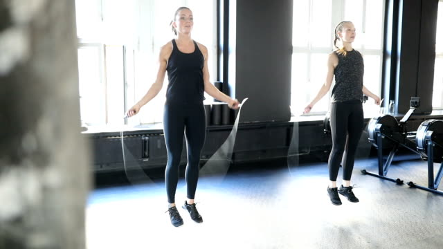 sporty women doing workout with jump ropes in gym - rope stock videos & royalty-free footage
