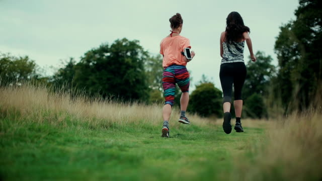 sporty women running together - hyde park london stock videos & royalty-free footage