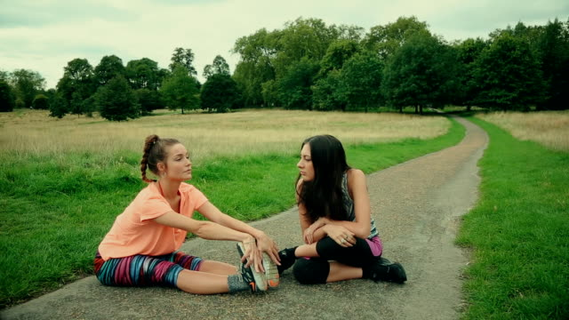 sporty women stretching muscles and talking - studded stock videos and b-roll footage