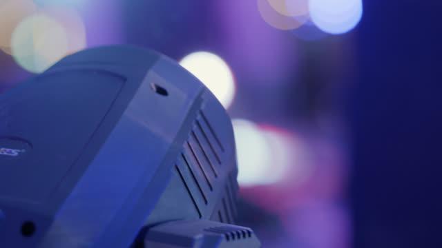 cu. spotlight spins lighting up a popular music festival - rampenlicht stock-videos und b-roll-filmmaterial