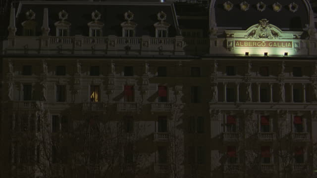 Spotlights illuminate a sign on the Le Meridien Gallia in Milan.