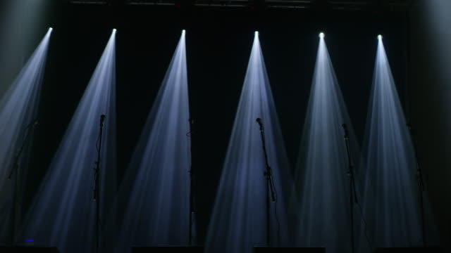 ws spotlights illuminating microphones on an empty stage - stage performance space stock videos and b-roll footage