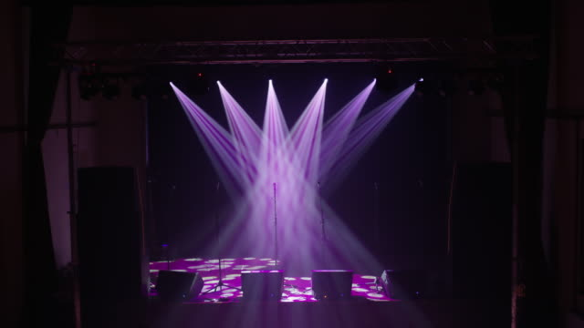 WS Spotlights illuminating microphones on an empty stage